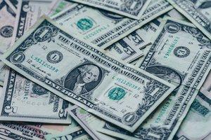 dollar bills pile